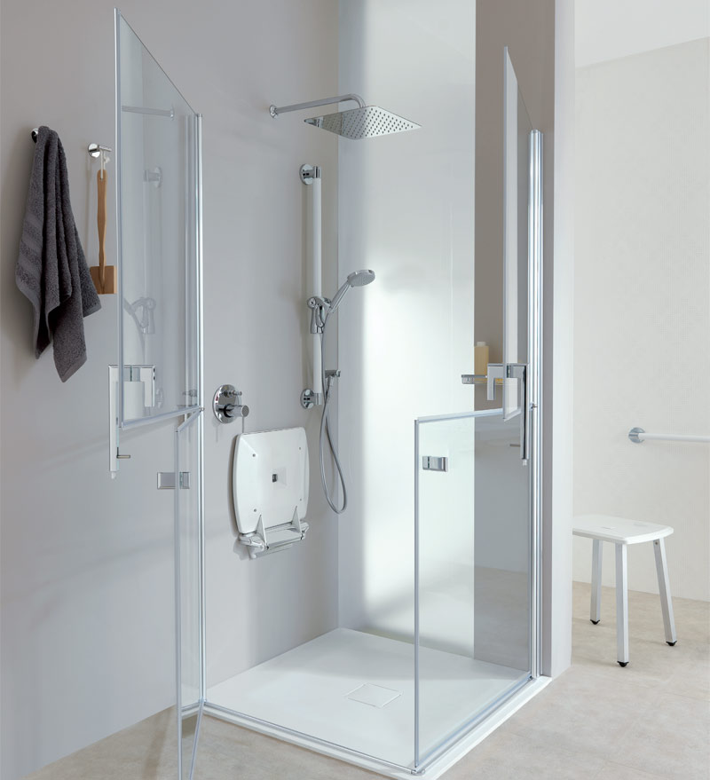 Shower with wall mounted seat, grab bar and shower unit with double doors
